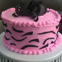Hot Pink And Zebra   Hot Pink buttercream with fondant accents