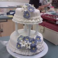 Wilton Class Wedding Cake I was really happy with my flowers on this, and my first tiered cake! I messed up in about 2-3 places while smoothing the fondant, but I&#...