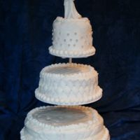 White Wedding  Top Tier- devil's food, buttercream icing, buttercream fondant, silver balls in clusters, buttercream stringwork Middle Tier- White...