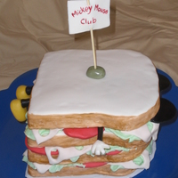 Mickey Mouse Club Cake measures roughly 7.5 inches square. The bread is cake, everything else is fondant - tons of fondant!
