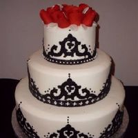Moorish/spanish Wedding Theme Fondant with Arabesque fondant cutouts in black covered with black sugar glitter, black dragees, pearl dragees, red gumpaste roses with...