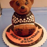 Build A Bear For Jana Chocolate pound cake with buttercream icing base covered with demerara sugar for fur. Buttercream clothes to match little girl's...