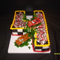Big 4 2D cake. Carved from 1/4 sheet cake. All butter cream with red & black sprinkles.