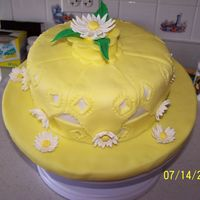 Fondant & Gumpaste Course Final Cake Using the handkerchief cake design in the course book but changing from the third triangle punch to adding the daisies.