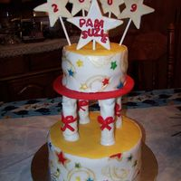 Pam & Suzie's Graduation Cake This graduation cake was made using the Wilton directions from the new yearbook(2010)