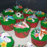 Soccer Cupcakes These were made for a little girl's soccer party. I added shoe laces after the picture was taken. Wish I had pictures of that, they...