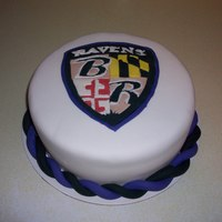 Fondant Baltimore Ravens Cake Marshmallow fondant on the cake and the shield logo and the border was made with gumpaste. This is my first fondant cake