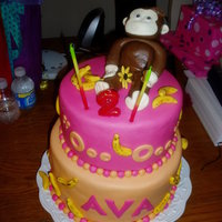 Curious George   Monkey cake I made for my daughter's second birthday! Everything was made with pina colada flavored MMF.