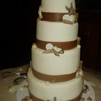Seashell Wedding Cake Completely edible. MMF, gum paste sand dollars and chocolate shells dusted with edible glitter.