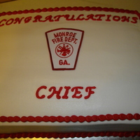 Retirement Cake For A Firefighter BC icing. The patch is from the fire department. TFL!