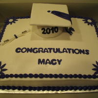 Graduation Cake BC icing w/fondant accents. Grad hat made from styrofoam ball and cardboard...TFL!