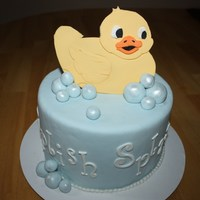 Splish Splash Baby Shower Cake Covered in fondant with fondant bubbles dusted with Pearl Luster Dust and duck was handcut, using a template, out of gumpaste.. TFL!