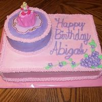 Barbie   Yellow Cake w/Buttercream Dream icing for a 5 yr old's birthday. The mom provided the cake topper.