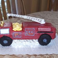 Fire Truck Cake Sculpted shape, all B/C. Frosted smooth using VIVA method. Lots of things went wrong and had to do last minute improvising for windows,...