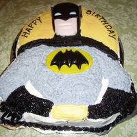 Batman Shaped Cake  This is the Wilton, Batman pan that comes with plastic face, and chest plate. I don't know why, but the mask was turquoise, so I used...
