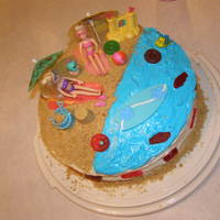 Beach Birthday   Yellow Cake, buttercream frosting, graham cracker pie crust for sand. And a little help from my kids who added the toys!