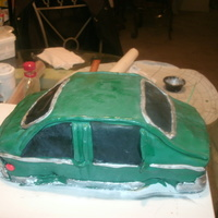 First Car Cake Minus The Wheels   first layer chocolate,second layer pina cola buttercream icing cover with fondant