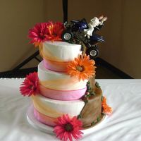 Four Wheeler Wedding Cake  This was my first wedding cake - I was so nervous when the bride told me she wanted a dirt trail and a four wheeler up the side of her cake...