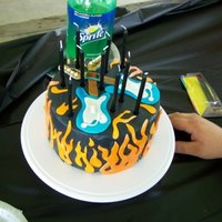 Rockband Cake   all fondant - handmade rockband guitars - airbrushed flames and guitars