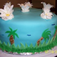 Luau Cake I made this cake for a luau party. It is covered with fondant with royal icing flowers on top. Thanks for looking