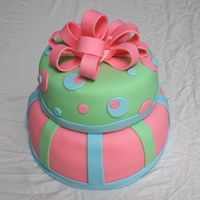 "Tiered Dots & Stripes This is my first tiered cake and fondant bow, and my second fondant cake! It is a 10"" white cake and 8"" chocolate cake."