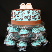 "Elegant Baby Boy Shower This was my first cupcake/cake tower. How fun to do! The cake is an 8"" coconut cake with buttercream frosting and fondant ribbon. The..."