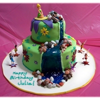 "Tinkerbell Birthday This is a tiered 10"" chocolate cake and 6"" white cake. Birthday girl loved the Disney Fairies, especially Tinkerbell. Cakes are..."