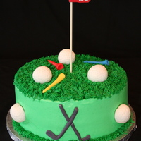 "Golf Birthday Cake This is a 10"" confetti cake, iced in buttercream with fondant golf clubs, tees, balls (also RKT) and flag. It was a two-person..."