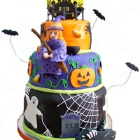 Three Tier Halloween Cake This 10/8/6 cake is made with chocolate, white, and pumpkin spice cakes. Covered in MFF. Decorations and figures made entirely of gumpaste...