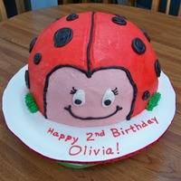 "Ladybug Cake This is an all buttercream cake. A round 8"" layer and a half-sphere layer of chocolate WVSC cake, with cookies & cream filling...."