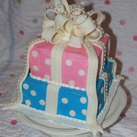 "Polka Dot Reveal Cake 8"" and 6"" square blue-colored vanilla cake. MFF bow and RI dots. Client is having her son cut into it at a Reveal Party with..."
