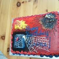 Marvel Heros child help do the webbing, she is learning how to do cakes.