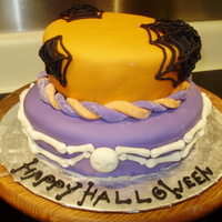 Halloween Cake This cake was a lot of fun! It was made for a local church's fall festival cake walk. 8 in and 6 in tiers. Butter yellow cake dyed...