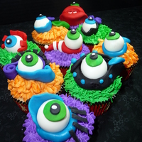 Monster Eye Cupcakes Vanilla cupcakes with Vanilla Buttercream and individual fondant monster eyes.