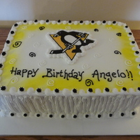 Pittsburgh Pengiuns Cake Chocolate Cake filled with Peanut Butter cream and iced in Vanilla Buttercream.