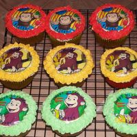Curious George   vanilla cupcake with edible image and buttercream icing.