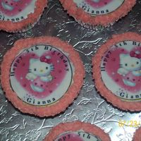 Hello Kitty Cupcake And Cake  The little girl love chocolate so everything was chocolate cupcake with edible image of hello kitty. And the cake was chocolate with...