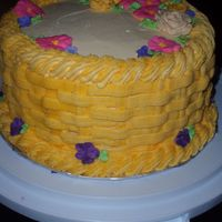 Basket Of Flowers I was very proud of this one as my first cake with a basket weave technique! I think it was a lemon flavored cake and buttercream