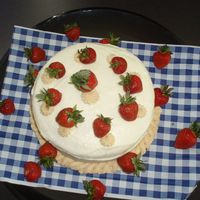 Red Velvet Cake This is a red velvet cake with a white chocolate cream cheese icing with fresh strawberries as decoration. Yummy!