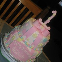 Baby's First Birthday two tier, eight and ten inch cake ...chocolate and vanilla. both tiers are covered in fondant.