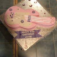 Pink Guitar Guitar cake for 6 year old.