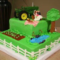 Farm Themed Groom's Cake 8 inch on 12 inch square covered in MFF. All accents are made of fondant, except for the toy tractor.