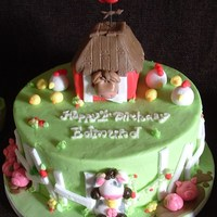 "Old Mcdonald Had A Farm 8 inch chocolate cake Iced in spring green butter cream with a 3 inch vanilla smash cake ""barn"" on top. All decorations are..."