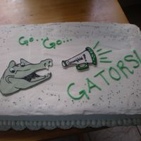 Last Day Of School Vanilla Buttermilk cake with buttercream. Fondant/gumpaste decorations. School mascot is a Gator. TFL.