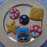 Mario Themed Cookies Cookies for my husband and his unit! :] Sugar Cookies with IAMBAKER(blog) glace icing. It's delicious! Thanks for looking.