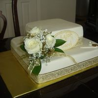 50Th Wedding Anniversary MMF, White cake filled with rasberry preserves. This cake is for my clients parents who love golf so I addes small golf accents...TFL!