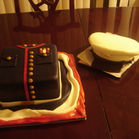 Marine Cake I made this for a friends brother in-law who leaving back to the Marine's. It's a chocolate kahluah fudge cake filled with...