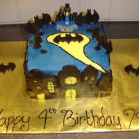 Batman Cake This was fun to make...not perfect but fun for sure! Vanilla BC with fondant accents. Cake is Yellow but mixed it up a bit and made half...