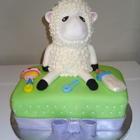 "Baby Shower Cake I tried to copy the lamb from ""springlakecakes"", it was so fun!!!! the decorations are all MMF except the wool on the little lamb..."