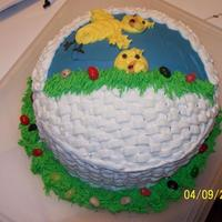 Easter 2009 This was actually a pretty easy cake one I got the hang of basket weaving...lol (date on pic is wrong)